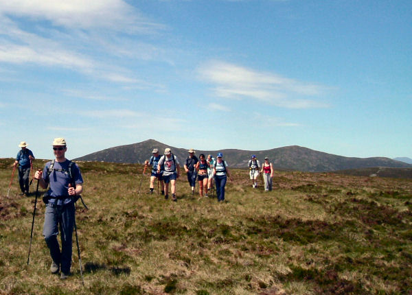 Headed for Cnoc na Scolog with Knockmealdowns behind.