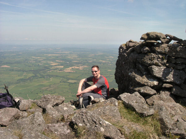Aidan enjoys the view from the summit of Cnoc an Aifrinn.